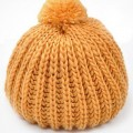 Buy Solid Color Pompom Beanie with discount from OASAP.